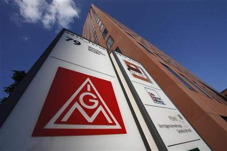 A logo of Germany's metalworkers' union IG Metall (IGM) is pictured past its headquarters in Frankfurt May 3, 2012. Workers in Germany's engineering and metalworking sector aim to begin work stoppages after unions failed to agree with employers to raise wages by 6.5 percent. REUTERS/Ralph Orlowski (GERMANY - Tags: BUSINESS EMPLOYMENT POLITICS LOGO CIVIL UNREST)