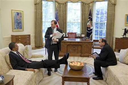 U.S. President Barack Obama talks with Deputy National Security Advisor for Strategic Communication Ben Rhodes (C) and Senior Advisor David Axelrod (R) in the Oval Office, in this White House handout photograph taken on May 21, 2010 and released on June 7, 2010. REUTERS/Pete Souza/The White House/Files