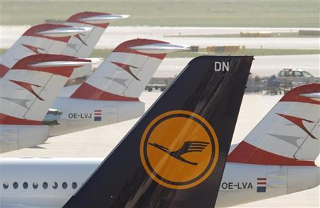 The tail fin of a Lufthansa aircraft is pictured next to Austrian Arrows planes parked at the Vienna International Airport September 7, 2012. REUTERS/Heinz-Peter Bader
