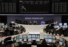 Traders are pictured at their desks in front of the DAX board at the Frankfurt stock exchange December 28, 2012. REUTERS/Remote/Joachim Herrmann (GERMANY - Tags: BUSINESS)