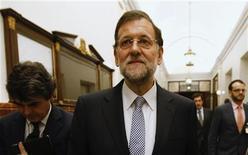 Las administraciones públicas cerraron el tercer trimestre con un déficit conjunto de 55.348 millones de euros, según cifras del Ministerio de Hacienda, lo que supone cerca del 5,3 por ciento del PIB. Imagen del presidente del Gobierno, Mariano Rajoy, tras la votación que aprobó los presupuestos para 2013 en el Congreso de los Diputados en Madrid el 24 de octubre. REUTERS/Andrea Comas