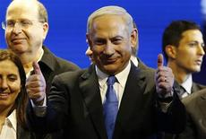 Israel's Prime Minister Benjamin Netanyahu (C) is seen during the launch of his Likud Beiteinu party campaign ahead of the upcoming January 22 national elections, in Jerusalem December 25, 2012. REUTERS/Ronen Zvulun