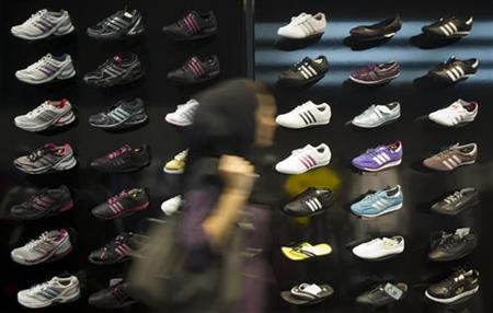 An Iranian woman walks past a window of an Adidas store in northern Tehran October 24, 2010. REUTERS/Morteza Nikoubazl/Files