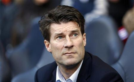 Swansea City's manager Michael Laudrup attends their English Premier League soccer match against Tottenham Hotspur at White Hart Lane in London December 16, 2012. REUTERS/Stefan Wermuth