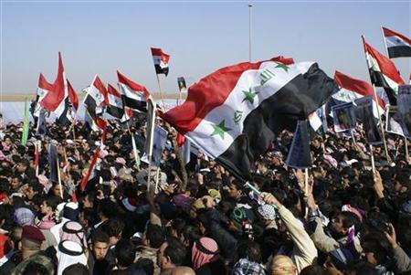 Iraqi Sunni Muslims wave the old flag of Iraq during an anti-government demonstration in Ramadi, 100 km (62 miles) west of Baghdad, December 26, 2012. REUTERS/Stringer