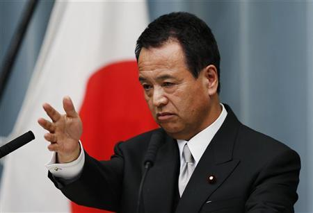 Japan's newly-appointed Minister for Economic Revival Akira Amari speaks at a news conference in Tokyo December 27, 2012. REUTERS/Toru Hanai