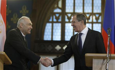 Russia's Foreign Minister Sergei Lavrov (R) shakes hands with his Egyptian counterpart Mohamed Kamel Amr during a news conference in Moscow December 28, 2012. Lavrov urged the Syrian government on Friday to act on its stated readiness for dialogue with opponents, amid a diplomatic push to end a 21-month-old conflict in Syria. REUTERS/Sergei Karpukhin