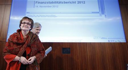 Bundesbank Vice President Sabine Lautenschlaeger (L) and board member of Bundesbank Andreas Dombret arrive for a news conference in Frankfurt November 14, 2012. REUTERS/Lisi Niesner
