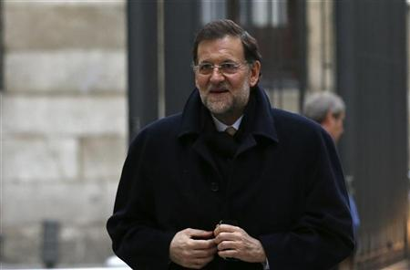 Spain's Prime Minister Mariano Rajoy arrives at parliamentary session for the formal approbation of the budget for 2013 at Parliament in Madrid December 20, 2012. REUTERS/Juan Medina