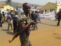 A soldier smiles as women march to protest against the conflict in their country in the streets of Bangui December 28, 2012. REUTERS/Stringer