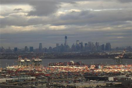 The skyline of Lower Manhattan in New York is seen behind the shipping docks in Newark, New Jersey, December 27, 2012. REUTERS/Gary Hershorn