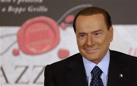 Former Italian Prime Minister Silvio Berlusconi attends the book launch of his friend, TV presenter Bruno Vespa, in Rome December 12, 2012. REUTERS/Tony Gentile