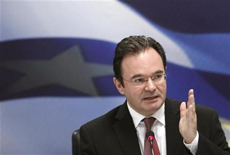 Greek Finance Minister George Papaconstantinou delivers a speach during a news conference in Athens June 10, 2011. REUTERS/John Kolesidis