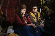Attawapiskat Chief Theresa Spence (L) pauses while speaking with journalists about her hunger strike with elder Danny Metatawabin in a teepee on Victoria Island in Ottawa December 27, 2012. REUTERS/Chris Wattie