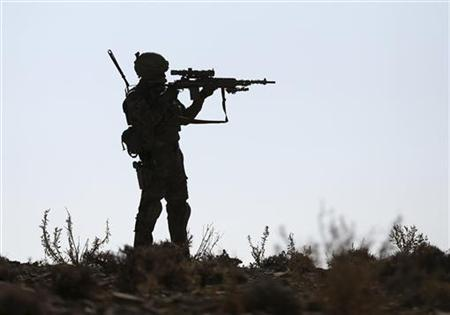 A U.S. soldier of B Troop, 1st squadron of 4th US Cavalry Regiment, observes the area with the scope of his rifle near COP (Combat outpost) Sar Howza in Paktika province October 29, 2012. REUTERS/Goran Tomasevic