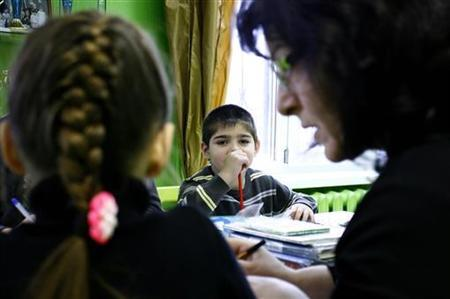 Orphan children attend a class at an orphanage in the southern Russian city of Rostov-on-Don, December 19, 2012. REUTERS/Vladimir Konstantinov