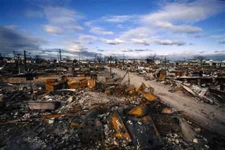 Clouds roll over destroyed homes, almost two months after superstorm Sandy caused damage in the region of Breezy Point of Queens borough, New York, December 27, 2012. REUTERS/Lucas Jackson