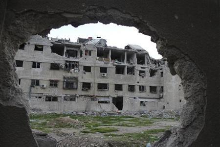 A general view of buildings, damaged by what activists said were missiles fired by a Syrian Air Force fighter jet of forces loyal to Syrian President Bashar al-Assad, at Zamalka near Damascus December 19, 2012. REUTERS/Karm Seif/Shaam News Network/Handout