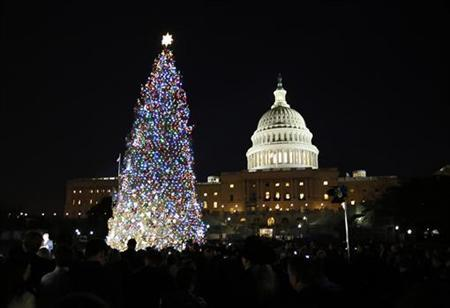 The U.S. Capitol Christmas Tree is pictured against a backdrop of the U.S. Capitol Building in Washington, December 4, 2012 during the official lighting ceremony for the tree. REUTERS/Jason Reed