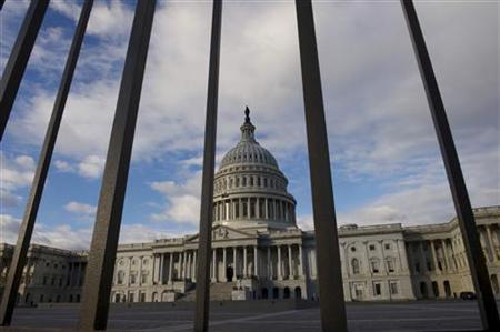 The U.S. Capitol building is pictured behind a fence as lawmakers return from the Christmas recess in Washington December 27, 2012. REUTERS/Mary F. Calvert