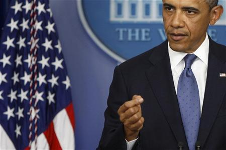 U.S. President Barack Obama makes a point during remarks to reporters after meeting with congressional leaders at the White House in Washington, December 28, 2012. REUTERS/Jonathan Ernst