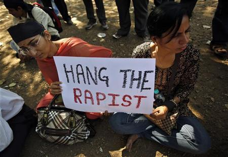 Protesters hold a sign as they participate in a demonstration to mourn the death of a rape victim, who was assaulted in New Delhi, in Mumbai December 29, 2012. REUTERS/Vivek Prakash
