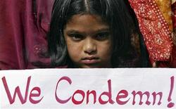 A girl holds a placard as she takes part in a protest rally in the southern Indian city of Hyderabad December 29, 2012. REUTERS/Krishnendu Halder