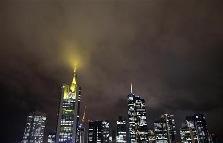 The skyline with the German Commerzbank headquarters (2nd L) is pictured under a cloudy sky in downtown Frankfurt November 7, 2012. REUTERS/Lisi Niesner