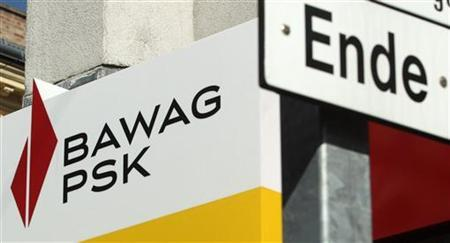 The logo of Austrian lender BAWAG PSK is pictured next to a traffic sign at a branch office in Vienna September 18, 2012. REUTERS/Heinz-Peter Bader