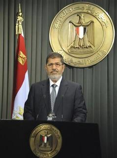 Egypt's President Mohamed Mursi speaks to the nation after signing Egypt's new constitution in Cairo December 26, 2012, in this handout photo released by Egyptian Presidency office. REUTERS/Egyptian Presidency/Handout