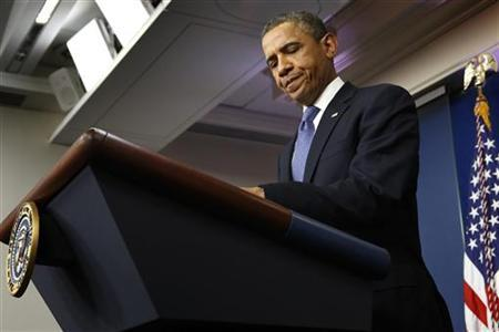 U.S. President Barack Obama opens his notes before remarks to reporters after meeting with congressional leaders at the White House in Washington December 28, 2012. REUTERS/Jonathan Ernst
