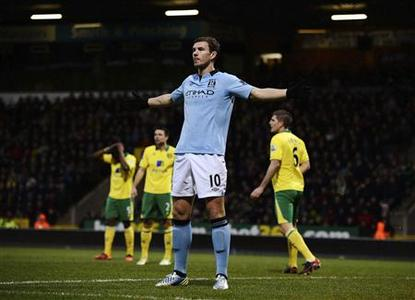 Manchester City's Edin Dzeko celebrates after scoring his first goal against Norwich City during their English Premier League soccer match at Carrow Road in Norwich December 29, 2012. REUTERS/Dylan Martinez