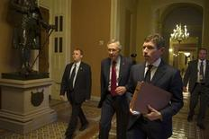 Senate Majority Leader Harry Reid (D-NV) (2nd L) walks with unidentified aides and security to his office at the U.S. Capitol after returning from a meeting with President Barack Obama at the White House in Washington December 28, 2012. REUTERS/Mary Calvert