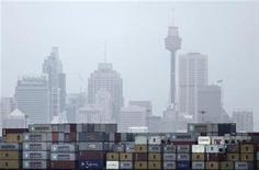 A container ship passes in front of the Sydney skyline as it departs from Port Botany terminal February 24, 2010. REUTERS/Tim Wimborne