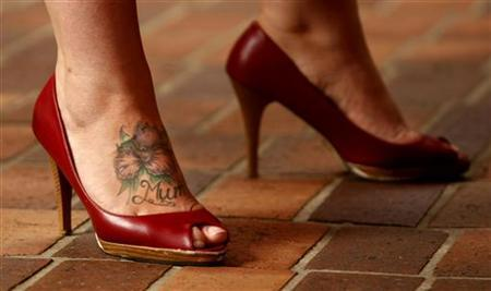 A sex worker sporting a tattoo on her foot in central Sydney December 13, 2007. REUTERS/Tim Wimborne/Files