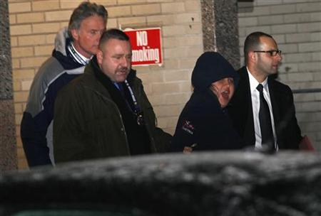 New York City police officers escort 31-year-old Erika Menendez to an awaiting car as she screams, at New York City Police department 112th Precinct in the Queens Borough of New York, December 29, 2012. REUTERS/Joshua Lott