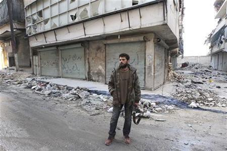 A Free Syrian Army fighter carries his weapon as he stands on a street in Aleppo December 29, 2012. REUTERS/Muzaffar Salman