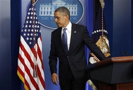 U.S. President Barack Obama leaves the lectern after delivering a statement to reporters following a meeting with congressional leaders at the White House in Washington December 28, 2012. Obama held out hope for a last-minute agreement to avoid the fiscal cliff of tax increases and spending cuts after a meeting with congressional leaders, scolding Congress for leaving the problem unresolved until the eleventh hour. REUTERS/Jonathan Ernst (UNITED STATES - Tags: POLITICS BUSINESS)