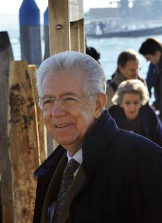 Outgoing Italian Prime Minister Mario Monti smiles during a private visit in Venice December 29, 2012. REUTERS/Stringer (ITALY - Tags: POLITICS)