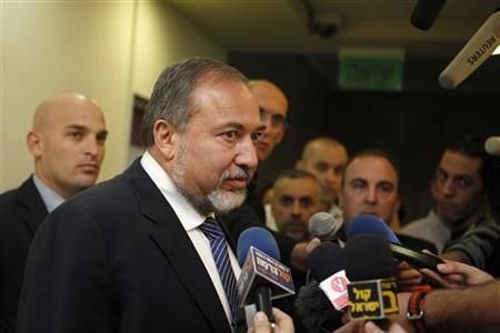 Israel's Foreign Minister Avigdor Lieberman speaks to the media before the weekly cabinet meeting in Jerusalem December 16, 2012. Lieberman formally tendered his resignation as Israel's foreign minister on Sunday and said he would focus on campaigning for next month's election on a joint ticket with Prime Minister Benjamin Netanyahu. REUTERS/Gali Tibbon/Pool (JERUSALEM - Tags: POLITICS)