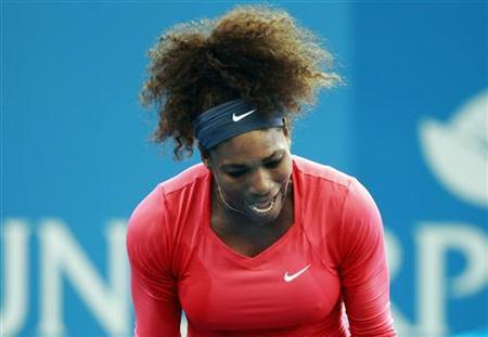 Serena Williams of the U.S. reacts after missing a point against compatriot Varvara Lepchenko during their women's singles match at the Brisbane International tennis tournament December 30, 2012. REUTERS/Daniel Munoz