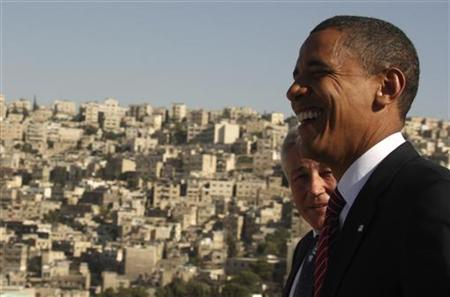 US Democratic presidential candidate Senator Barack Obama (D-IL) (R) shares a laugh with Senator Chuck Hagel (R-NE) at the Amman Citadel in Amman July 22, 2008. REUTERS/Ali Jarekji