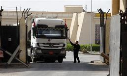 A truck loaded with building materials drives at the Rafah crossing with Egypt, in the southern Gaza Strip December 30, 2012. Islamist-led Egypt allowed building materials into Gaza via the Rafah crossing on Saturday for the first time since Hamas seized control of the Palestinian enclave in 2007, an Egyptian border official said. REUTERS/Ibraheem Abu Mustafa
