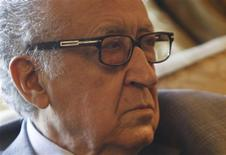 "International peace envoy for Syria Lakhdar Brahimi attends a meeting with Arab League Secretary-General Nabil Elaraby (unseen) at the Arab League's headquarters in Cairo December 30, 2012. The international mediator touting a peace plan for Syria warned on Saturday of ""hell"" if the warring sides shun talks, and Moscow accused enemies of President Bashar al-Assad of blocking negotiations. REUTERS/Amr Abdallah Dalsh"