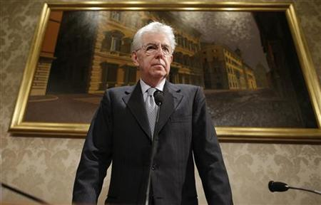 Italy's outgoing Prime Minister Mario Monti looks on during a news conference in Rome December 28, 2012. Monti said on Friday that he would lead a coalition of centrist parties who support his European and reform-minded agenda in the parliamentary election in just two months time. REUTERS/Tony Gentile