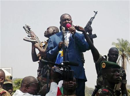 Central African Republic President Francois Bozize (C) speaks to a crowd of supporters and anti-rebel protesters during an appeal for help, in Bangui December 27, 2012. REUTERS/Stringer