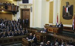 Egyptian President Mohamed Mursi delivers a speech to the Shura Council, or upper house of parliament, in Cairo in this handout taken December 29, 2012. Mursi said on Saturday his country supported the Syrian revolution and that President Bashar al-Assad's administration had no place in Syria's future. REUTERS/Egyptian Presidency/Handout
