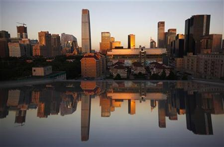 Residential and commercial buildings are seen reflected in a window during a sunset in Central Business District (CBD) of Beijing September 19, 2012. REUTERS/David Gray