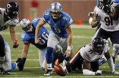 Detroit Lions quarterback Matthew Stafford (C ) chases the ball after a fumble and before Chicago Bears defensive end Julius Peppers (L ) recovers the ball during the first half of their NFL football game in Detroit, Michigan December 30, 2012. REUTERS/Rebecca Cook