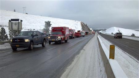 Rescue personnel respond to the scene of a charter bus crash on I-84, east of Pendleton, Oregon in this December 30, 2012 handout photo. Five people were killed and at least 20 injured in the incident. Police said the bus may have gone out of control on the highway before crashing through a guardrail and down an embankment. REUTERS/Oregon State Police/Handout